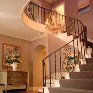 Color-changing LED lights illuminate this three-story domed foyer adding a distinctive touch.